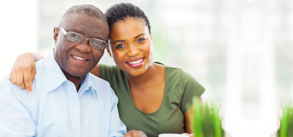 elder man and young woman smiling