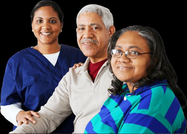 elderly couple and nurse smiling