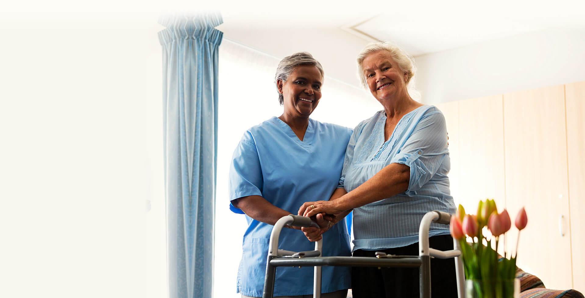 elder wowan accompanied by a nurse