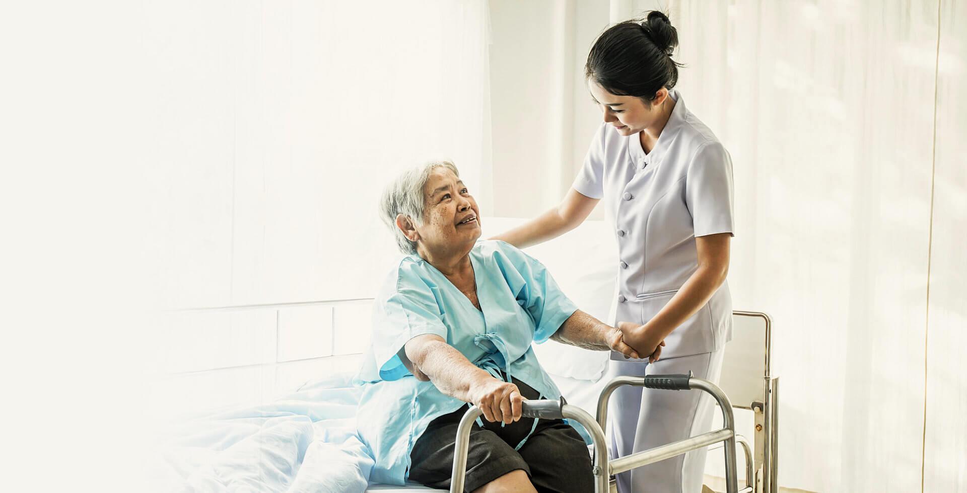 elder woman hospital accompanied by a nurse